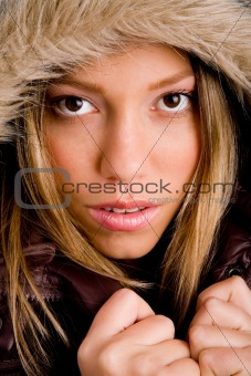 portrait of young woman holding her winter coat