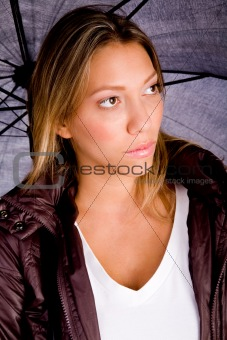 portrait of young female holding umbrella