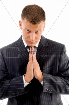 praying professional looking at camera