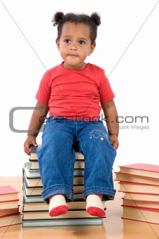 Baby sitting on a pile of books