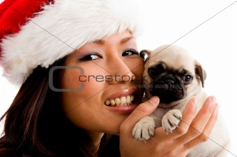 portrait of smiling woman with christmas hat and puppy