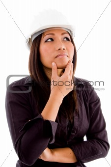 female asian architect thinking and wearing hardhat