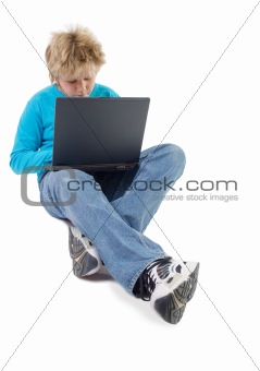 blonde boy working with laptop