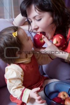 little girl and mother with apples