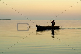 Lonely boat and beautiful sunrise