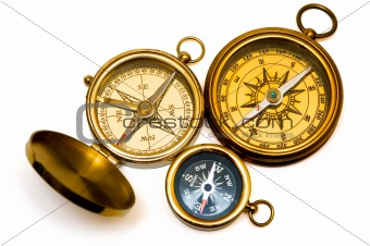 Three old style brass compasses