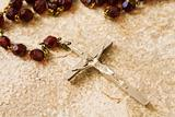 Rosary beads on stone