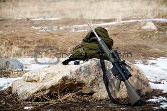 rifle on rock