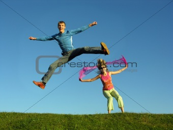 couples jump on grass