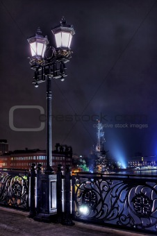 Old lantern on the bridge across Moskva River at night