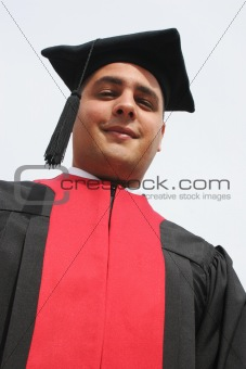 Attractive man in gowns on university graduation day