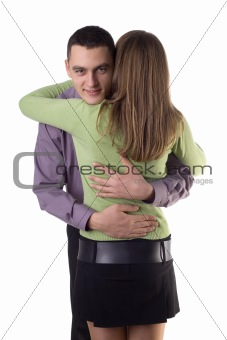 Cuddling couple - man's face to the camera.
