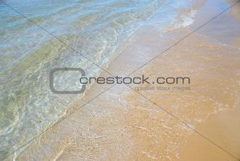 Beach wave sand