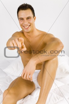 Man in the bed - pointing to you