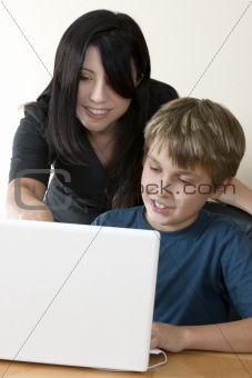 Adult woman and child at computer