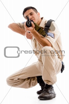 sitting soldier going to shoot with gun