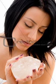 portrait of woman holding stone on an isolated background