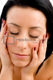 close up of face of woman on white background