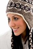 side pose of smiling woman wearing woolen cap on white backgroun