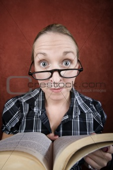 Woman with big eyes reading a book