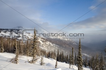 Alpine slope covered with snow