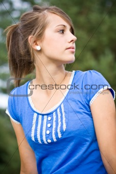 portrait of young girl in blue top