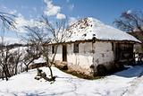 traditional Serbian farm house in winter