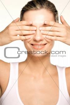 Beauty shot of girl hiding her eyes