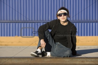 Boy with glasses in front of boxcar