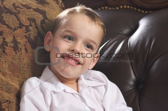 Adorable Young Boy with Blue Eyes Smiles for the Camera