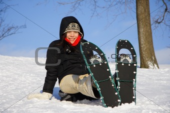 Young woman hiking with Snow shoes / Rackets