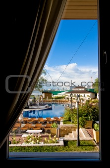 Beautiful view from the window on swimming pool