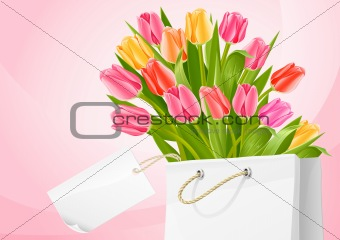 bouquet of tulip flowers in the bag with blank label