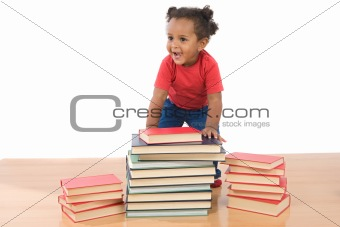 Adorable african baby with many books