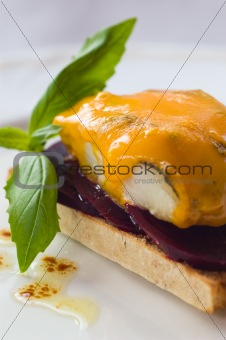 Smoked Haddock On A Bed Of Beet-root With Melted Blue Cheese