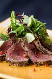 Seared Venison, Sliced And Served With A Green Salad And Citrus Dressing