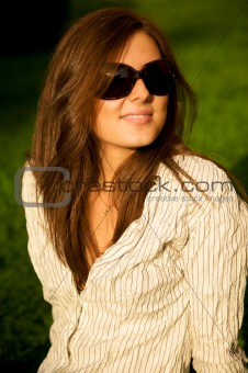 Young pretty smile girl in sunglasses