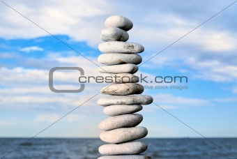 Grey stone tower on a beach