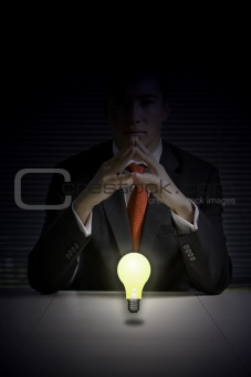 Business man with glowing light bulb