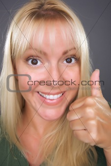 Beautiful Woman with a Thumbs Up Against a Grey Background.
