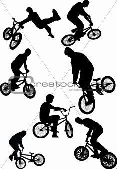 silhouette of bmx riders