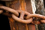 Rusty Chains on a Ship Dock