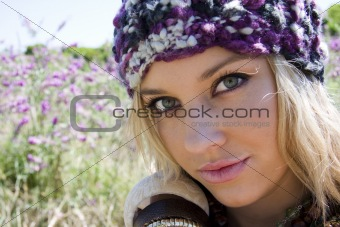 Attractive young woman in a field