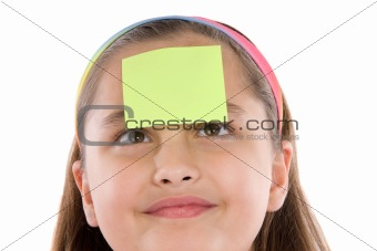 Adorable girl squint with post-it in her front