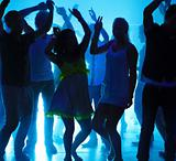 Young guys and girls dancing at a nightclub
