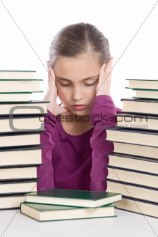 Adorable girl concentrated with many books
