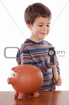 Adorable little boy with hammer for breaking the money box