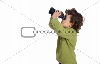 Adorable spy boy with binoculars