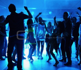 Silhouette of people dancing at a disco