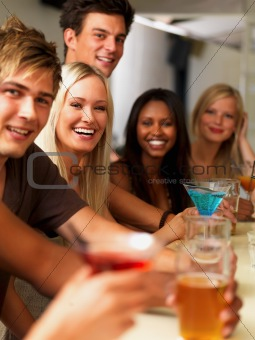 Closeup of joyful young people having drinks